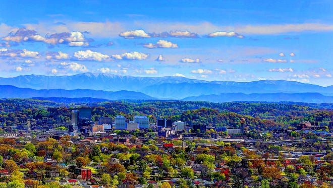 Jim Barnhart took this photograph from Sharps Ridge when the trees were turning green in April 2017. It shows downtown Knoxville among the hills and mountains of East Tennessee.