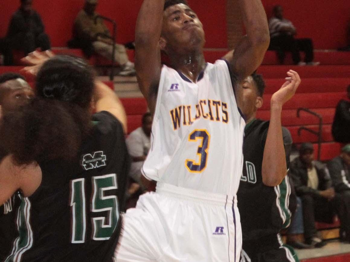 Wossman basketball enters 2015 with a new boys coach but a lot of returning players.