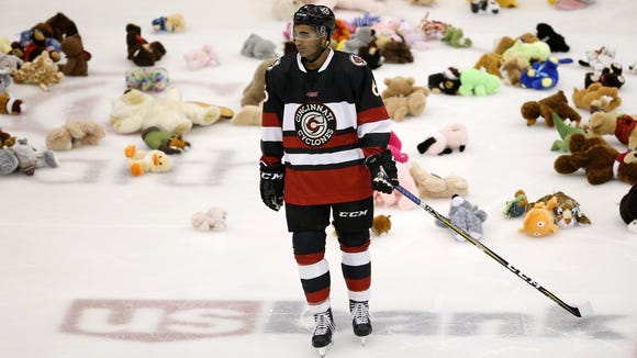 Cyclones defender Arvin Atwal (6) skates past a pile of donated teddy bears in the second period of the EHL hockey game between the Cincinnati Cyclones and the Wheeling Nailers at US Bank Arena in downtown Cincinnati on Saturday, Jan. 6, 2018.
