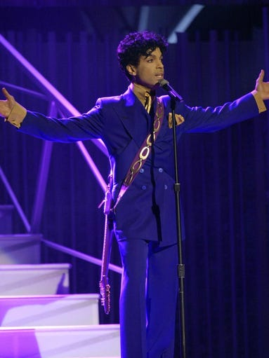 ** FILE ** Prince performs during the 46th Annual Grammy Awards in a Los Angeles, Ca. file photo from Feb. 8, 2004. The 'Purple Rain' singer will be honored with the 2005 NAACP Vanguard Award in a Los Angeles ceremony.