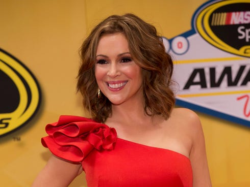 Alyssa Milano arrives at The NASCAR Sprint Cup Series auto racing awards ceremony on  Dec. 6, 2013 at The Wynn Resort & Casino in Las Vegas.