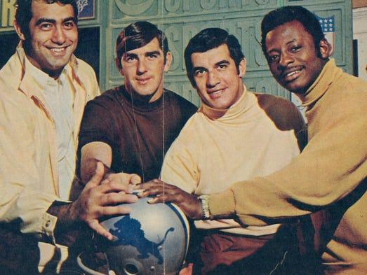 Detroit Lions' tackle Rockne Freitas, left, quarterback