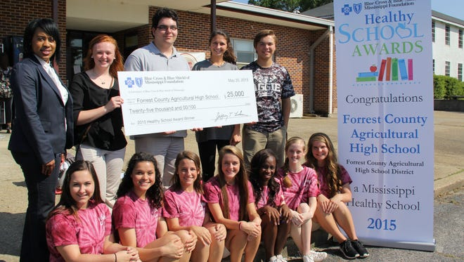 FCAHS students receive a $25,000 check from Blue Cross and Blue Shield of Mississippi