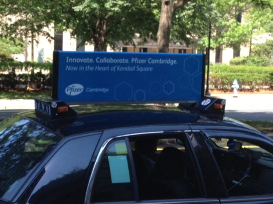 An ad on a Cambridge, Massachusetts, cab touts the