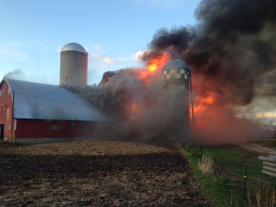A barn fire burns in Oak Township on May 3.