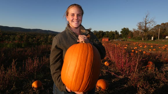 Sarah Dressel holds up a pumpkin at Dressel Farms in New Paltz Oct. 17, 2017.