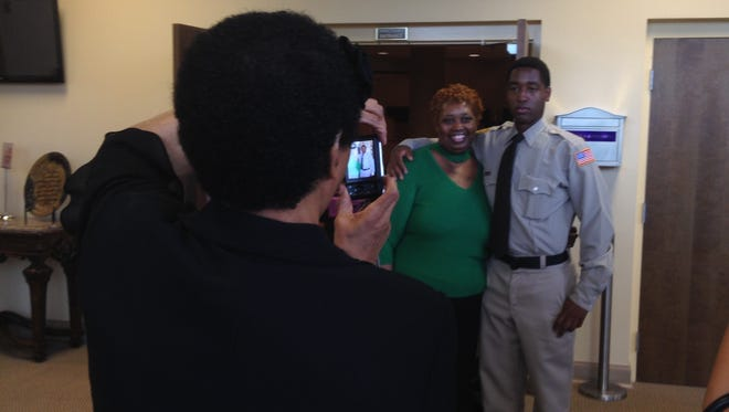 Family members took photos of 20-year-old Christopher Kelly following his graduation as a Memphis Police Service Technician.