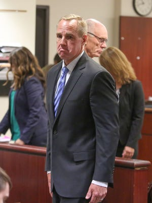 Steve Pougnet turns to exit the courtroom after a hearing at the Larson Justice Center related to the Palm Springs City Hall bribery and corruption scandal. Behind Pougnet is John Wessman who is also implicated in the case.