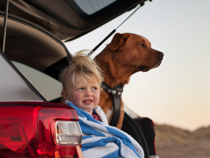 The Best Cars for Dogs, according to AutoTrader, with additions by Mark Phelan of the Detroit Free Press includes the Subaru Outback. A 2015 Outback with a boy and his dog is shown here.
