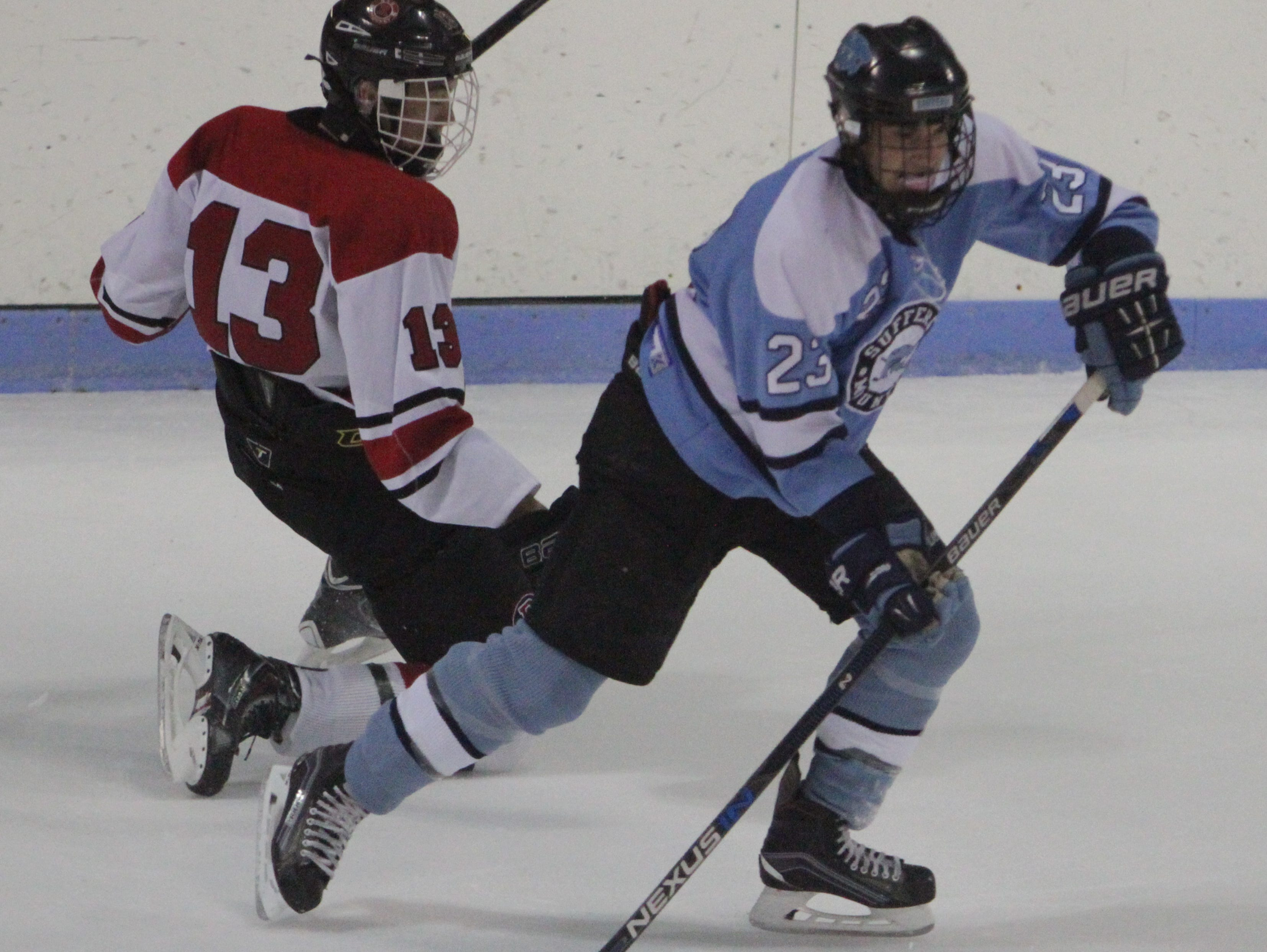 Suffern's CJ Greco goes around Rye's Guy Junkins during a Section 1 hockey game at the Playland Ice Casino in Rye on Wednesday, January 8th, 2016. Suffern won 3-2.
