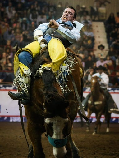 Justin Miller rides bareback in the 5th performance