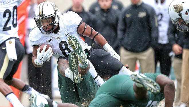 Purdue Boilermakers running back Markell Jones (8) is tackled by Michigan State Spartans defensive end Shilique Calhoun (89) during the 1st quarter of a game at Spartan Stadium.