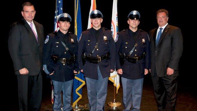 From left, Commissioner George N. Longworth, Police Officer Paul DeSousa, Police Officer Michael McAllister, Police Officer Richard Lepore and Deputy Commissioner Joseph Yasinski.