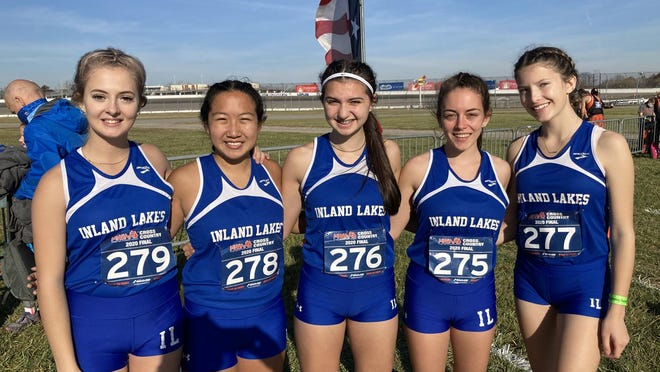 The Inland Lakes girls cross country team takes time out for a photo right before racing in the MHSAA Division 4 state finals held at Michigan International Speedway in Brooklyn on Saturday. Members of the Inland Lakes team include Christy Shank, Haivyn Fielder, Emma Duncan, Addelle Corps and Luci Bunker. The Bulldogs finished 23rd overall on the day.