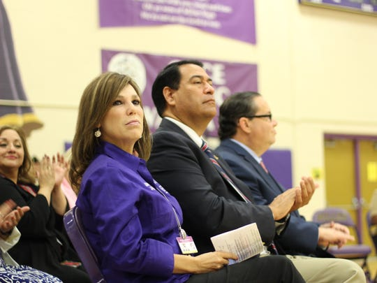 Roy Miller High School Principal Stella Torres, CCISD Superintendent Dr. Roland Hernandez and US Congressman Blake Farenthold applaud to recognize Veterans at the ceremony Friday.
