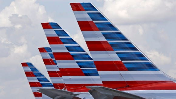 The tails of four American Airlines passenger planes