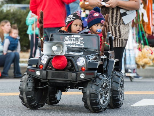 Two children with We Here Auto Club participate in the Salisbury Christmas Parade on Sunday, Dec. 3, 2017.