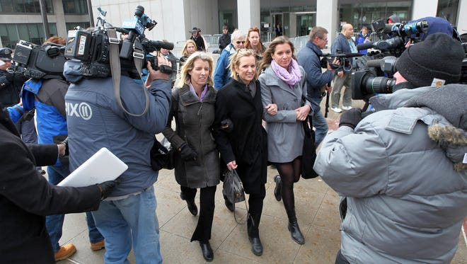 Surrounded by photographers, videographers and reporters, Kerry Kennedy, center, walks Feb. 26, 2014, from the Westchester County Courthouse in White Plains, N.Y., during the lunch break in her driving under the influence trial.