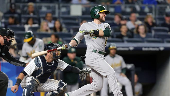 May 26, 2017; Bronx, NY, USA; Oakland Athletics second baseman Jed Lowrie (8) follows through on an RBI single against the New York Yankees during the eighth inning at Yankee Stadium. Mandatory Credit: Brad Penner-USA TODAY Sports