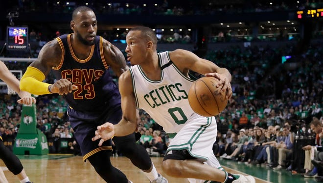 Celtics guard Avery Bradley drives against Cavs forward LeBron James in Game 5 of the Eastern Conference finals at the TD Garden.