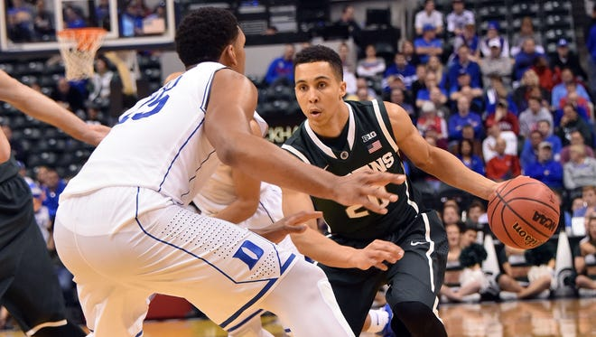 Travis Trice drives during MSU's 81-71 loss to Duke on Nov. 18 earlier this season in Indianapolis.