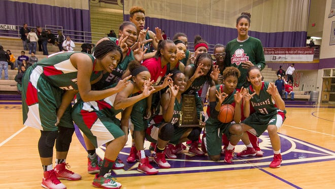 Lawrence North players celebrate after their victory over Roncalli. Lawrence North High School competed against Roncalli High School in the Championship game of the 2014 Marion County Girl's Basketball Tourney, Saturday, Dec. 13, 2014, at Ben Davis High School. Lawrence North defeated Roncalli 62-59.