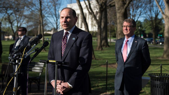 Secretary of Veterans Affairs Robert McDonald pledged Wednesday, April 20, 2016, to donate his brain to the Veterans Affairs-Boston University-Concussion Legacy Foundation for research. Here, McDonald addresses the media with Secretary of Defense Ash Carter after a wreath laying ceremony to mark the 50th anniversary of the Vietnam War at the Vietnam Memorial Wall in Washington on Tuesday, March 29, 2016.