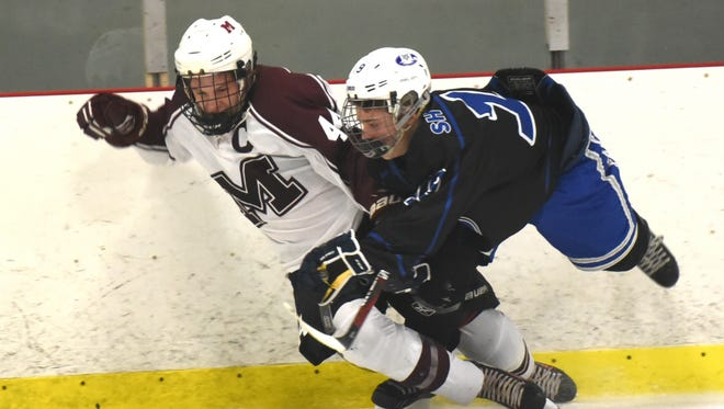 Maverick Michael Osinski (left) and Eagle Tyler Martin go flying into each other at the boards.