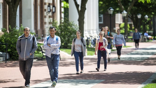 Students walk through the University of Delaware's campus in Newark on Wednesday afternoon. Applications to the campus are at record highs.