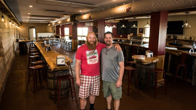 Todd Holsopple (left) and Brad Kleinfelter (right) pose for a picture in the bar area of Leed's Corner which houses Mount Gretna Craft Brewery and the Red Canoe and General Store has been up and running for about a month.