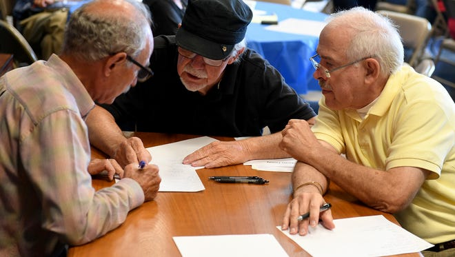 The Chester County Challengers, Dan Shull, Fred Watson, and Harold Jones, discuss their answer during the South West Area Agency on Aging and Disability regional Brain Games, Friday, Aug. 25. The Chester County Challengers were named winners of the distric round and will play in the regional round.