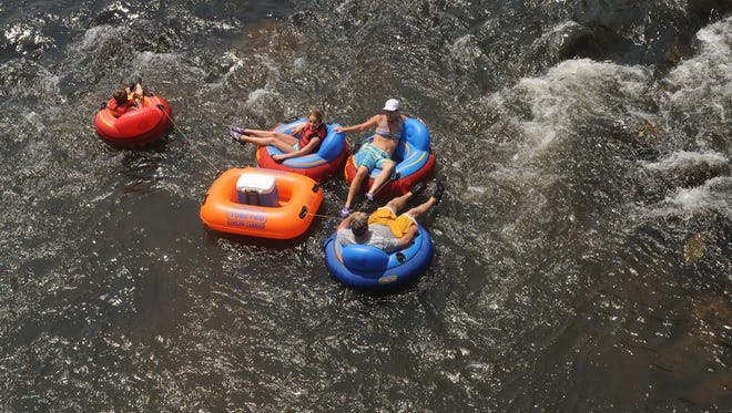 A family floats down the French Broad River in this 2012 photo. The state is making plans to keep the river open and safe for users during work to build a new bridge on I-26 over the river in southern Buncombe County set to start in 2019.