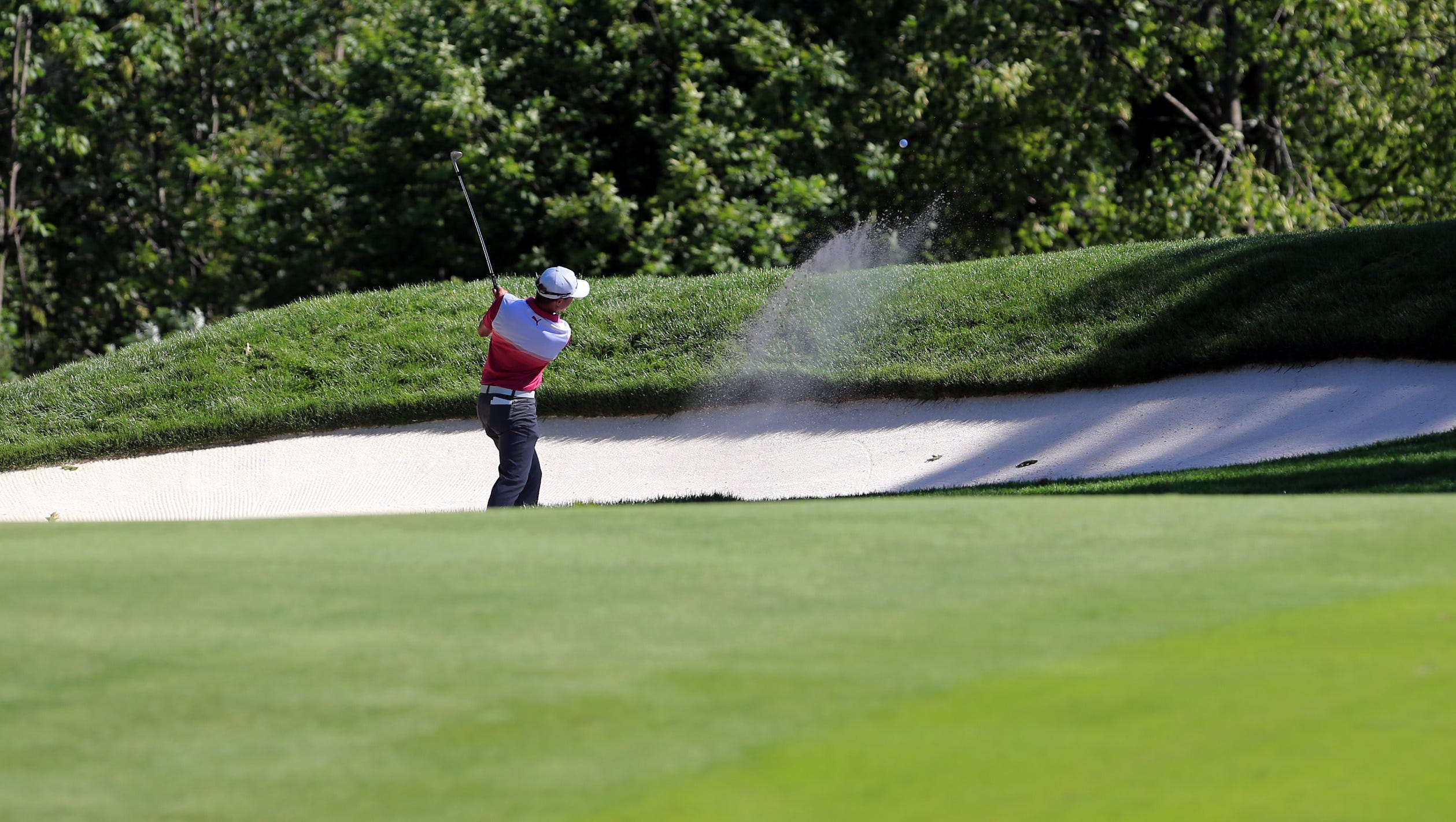Jonas Blixt plays out of a bunker on the 14th hole.