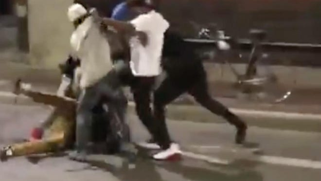 This video screen shot shows a fight in the streets in Detroit's Greektown business district that was brazenly broadcast on Facebook Live and left one man in serious condition.