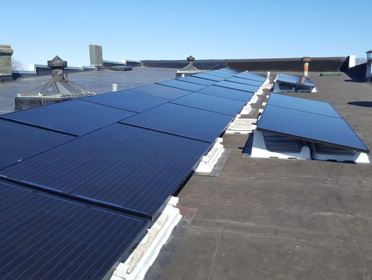 Solar panels on the roof of 2220 Division Street in