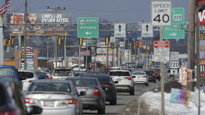 In this Sunday, Nov. 18, 2018, photo traffic moves along Plank Road in Altoona, Pa., Sunday, Nov. 18, 2018. (John Rucosky/The Tribune-Democrat via AP)