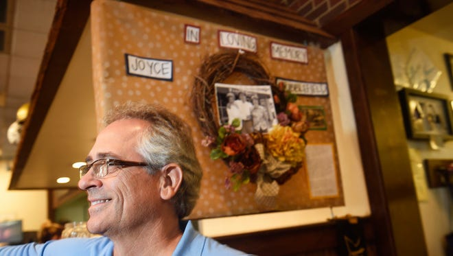 David Baldwin, owner of Pancake Pantry, stands in front of a memorial he put up for longtime server Joyce Stubblefield, who died a few weeks ago.