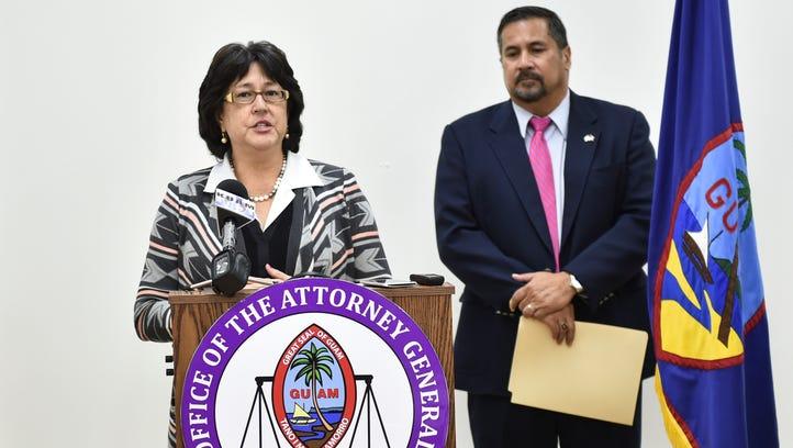 Attorney General Elizabeth Barrett-Anderson, left,