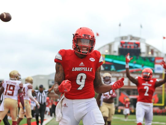 Louisville's Jaylen Smith celebrates as his run got the Cardinals close to the goal line in the first quarter as Louisville routed the Seminoles 63-20 Saturday afternoon.