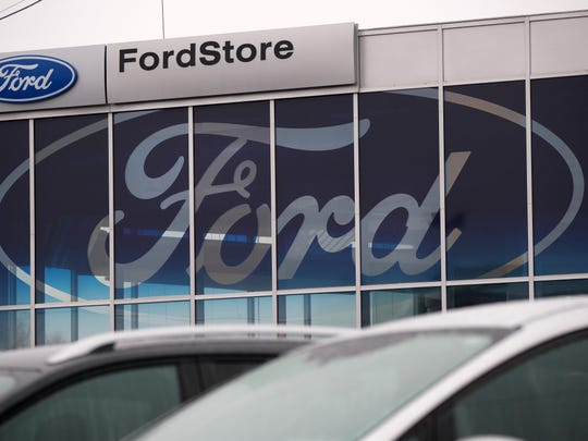 The Ford logo is seen at a Ford car dealership on January 11, 2019 in Berlin, Germany. Ford Motor Co. is reducing its German staff by more than 5,000, while cutting an unspecified number of jobs in the U.K. as part of a large-scale European revamp announced in January.