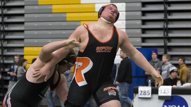 Ripon's Cody Jacobson, right, wrestles Pacelli's Cole Warzynski in the final day of the On The Water Classic wrestling tournament Wednesday.
