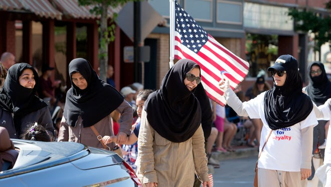 Members of the Ahmadiyya Muslim Community display their American pride in the Oshkosh Fourth of July parade on July 4, 2016.