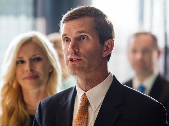 Attorney General Andy Beshear announces his campaign for governor alongside his wife last year.