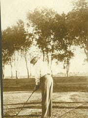 Dr. A.J. Chandler, playing golf at the San Marcos golf