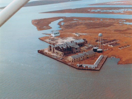 A abandoned fish processing plant stands on an island in Ocean County's Great Bay.