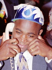 University of Florida's defensive tackle Ellis Johnson talks with Indianapolis Colts representatives announcing that he had been drafted by the Colts during the NFL draft Saturday April 22 l995.  Johnson 21 who was in Miami waiting for the announcement was picked 15th over-all.  (AP Photo/Alan Diaz)