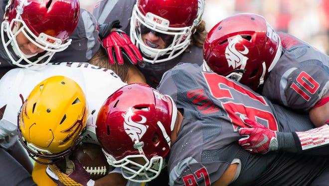 The Washington State defense swarms to the ball versus Arizona State.