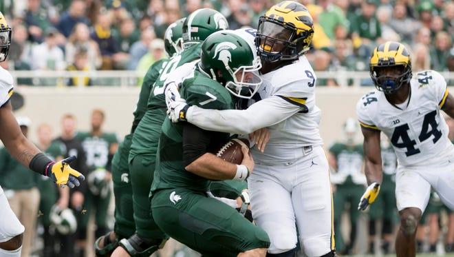 Michigan linebacker Mike McCray sacks Michigan State quarterback Tyler O'Connor in the second quarter.