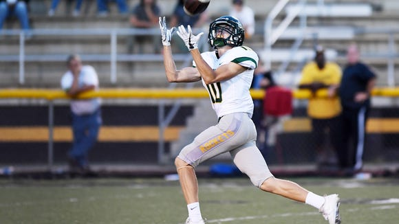 Reynolds' Kaedin Robinson reaches to catch the ball in the game against Tuscola in Waynesville September 28, 2017.