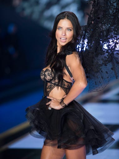 Adrianna Lima sprouts lacy black wings during the Victoria